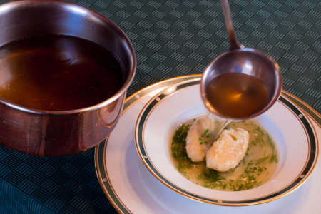 Serving Clear Beef Broth with Butter Dumplings, called Butternockerl in German, the Soup is Part of Traditional Austrian Cuisine