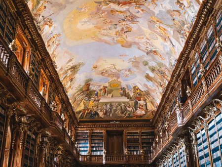Prague, Czech Republic - June 8 2019: Interior of Strahov Monastery Library, Philosophical Hall, Ceiling Fresco Mankinds Quest for True Wisdom painted by Anton Maulbertsch in 1794.
