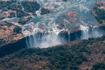 Victoria Falls Aerial View, Big Zambezi River Waterfall, between Zimbabwe and Zambia, Africa, a World Famous Tourist Attraction