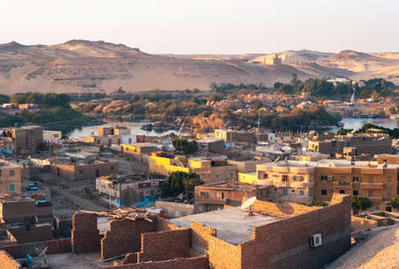 Aswan Cityscape of the Outskirts with River Nile Cataract, Aga Khan Mausoleum in the Evening Banco de Imagens
