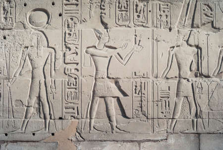Bas-Relief of Pharaoh Ramesses II delivering Maat Sacrifice to God Amun Ra, Exterior Wall of Karnak Temple, Luxor, Egypt