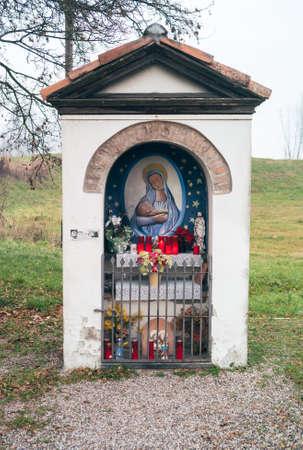 Brescello, Italy - January 1 2014: Madonna or Madonnina del Borghetto, a Famous Wayside Shrine from the Don Camillo Movies devoted to Saint Mary.