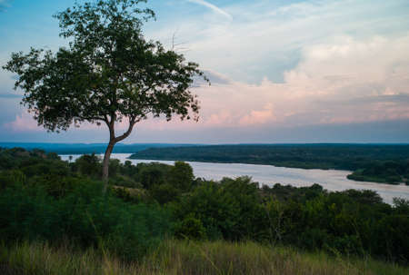River Nile at Dusk in near Paraa in Murchison Falls National Park, Uganda, Africa - Landscape of the Victoria Nile in the Evening