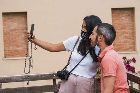 Castiglione d'Orcia, Italy -  August 18 2020: Tourists wearing Masks or Corona Virus Covid-19 Protection taking Selfie in Tuscany Redakční