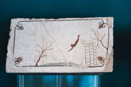 Paestum, Italy - August 25 2020: Tomb of the Diver or Tomba del Tuffatore, Cover Slab with fresco, an Arteact of Magna Graecia