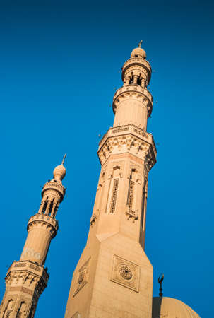 El Tabia Mosque Detail with two Minarets in Aswan - a Concept or Islam and the Orient against Blue Sky