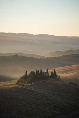 San Quirico d'Orcia, Italy - August 20 2020: Podere Belvedere Villa in Val d'Orcia Region in Tuscany at Sunrise or Dawn Reklamní fotografie