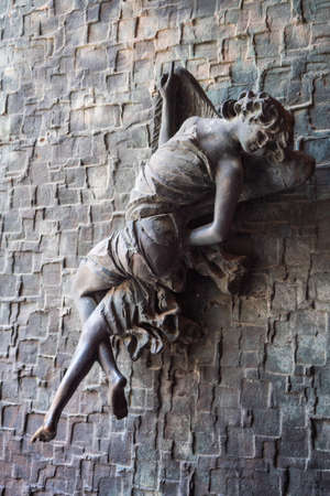 Orvieto, Italy - August 22 2020: Bronze Cherub Angel Figure with Wings, a Door Handle or Knob on the Cathedral of Orvieto, Umbria, Italy made by Emilio Greco Redakční