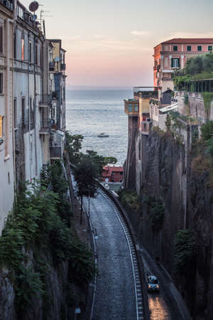 Via Luigi de Maio Street in Sorrento on the Sorrentine Coast in the Evening between the Cliffs with View of the Sea