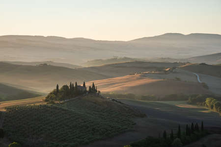San Quirico d'Orcia - August 20 2020: Podere Belvedere Villa in Val d'Orcia Region in Tuscany, Italy at Sunrise or Dawn Redakční