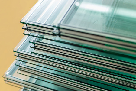 glass door: Sheets of Factory manufacturing tempered float glass panels cut to size Stock Photo