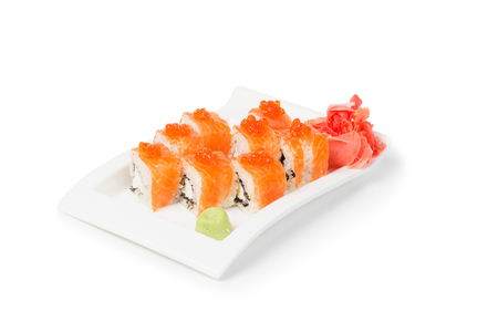 Maki Sushi roll, wasabi and ginger on the white plate