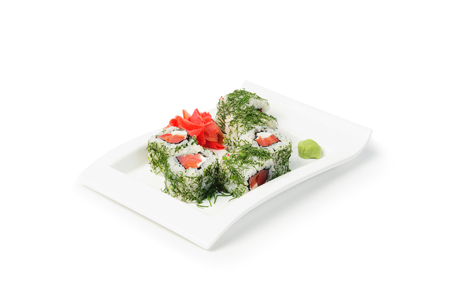 Delicious sushi rolls on white plate with wasabi isolated on white