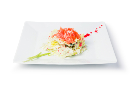 Square plate of salmon salad with caviar isolated on white background