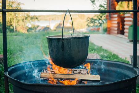 Pot on a fire. Traditional pilaf cooking over an open flame