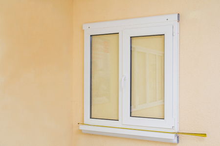 Sample of manufactured plastic window on the wall, ready to install