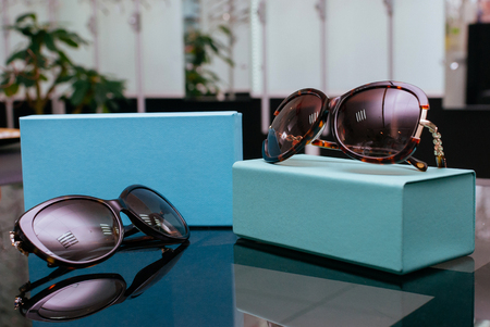 Modern fashion sun glasses with turquoise boxes