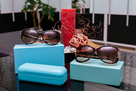 tiffany blue: Modern fashion sunglasses with turquoise boxes and spectacle-case