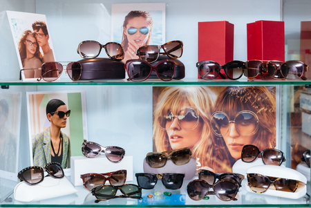 Modern fashion sun glasses on a shelf Stock Photo