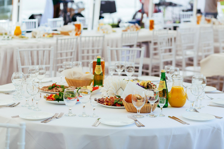 Preparation for a buffet. Restaurant table with food and drinks at event