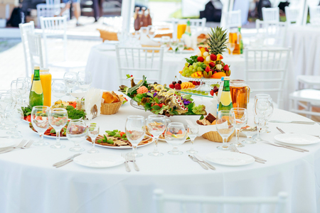 table set: Catering service. Set table for party or wedding banquet reception. Shallow depth of view