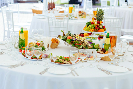 table set: Catering service. Set table for party or wedding banquet reception. Stock Photo