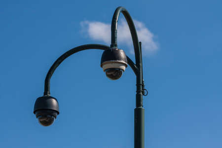 Surveillance CCTV security cameras on blue sky background Stock Photo