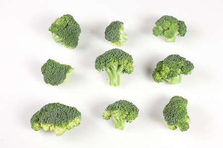 nourishing: Set of ripe broccoli pieces isolated on white background Stock Photo