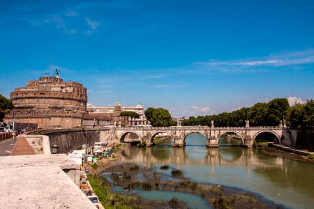 ROME,ITALY - JUNE 17,2011: Bridge of Umberto I and Mausoleum Castel Sant Angelo at sunset. The Mausoleum of Hadrian usually known as Castel Sant'Angelo is a towering cylindrical building in Rome. Editorial