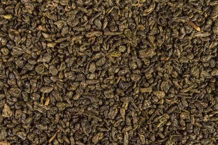 Dried leaves of green chinese gunpowder tea full frame image backgrounds Banco de Imagens