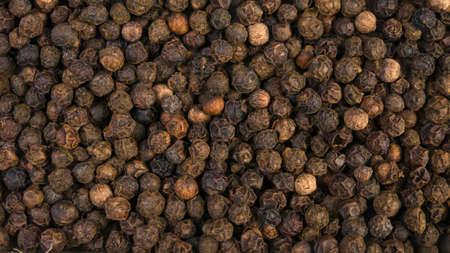 Black pepper peppercorns background. Natural seasoning texture. Stok Fotoğraf