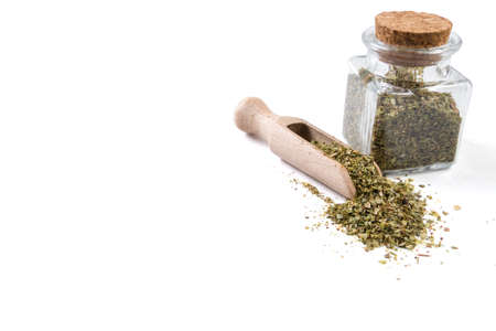 marjoram in wooden scoop and jar on isolated on white background. copy space added