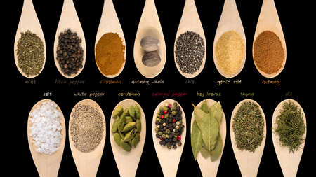 Set of various spices and food ingredients with labels isolated on black background. High resolution