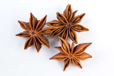 heap of anise stars isolated on white background