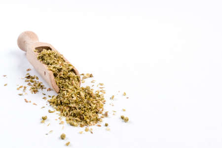 oregano herb in wooden scoop isolated on white background with copy space added