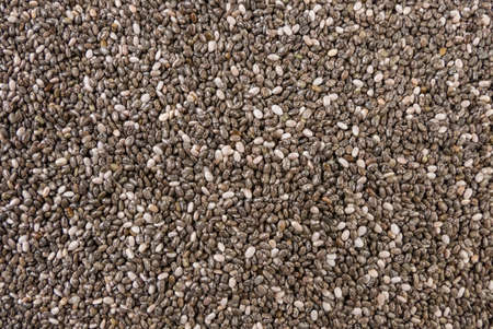chia seeds background. Natural seasoning texture. Natural spices and food ingredients. Stock Photo