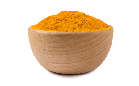 turmeric powder in wooden bowl isolated on white background. Spices and food ingredients.