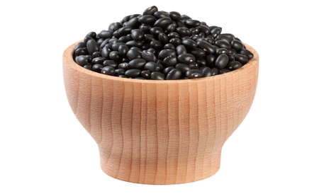 black bean in wooden bowl isolated on white background. nutrition. food ingredient.