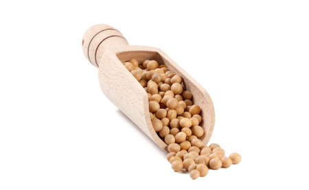 soy bean in wooden scoop isolated on white background. nutrition. food ingredient.
