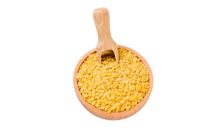 yellow lentils  in wooden bowl and scoop isolated on white background. nutrition. bio. natural food ingredient.