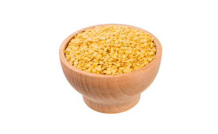 yellow lentils  in wooden bowl isolated on white background. nutrition. food ingredient.