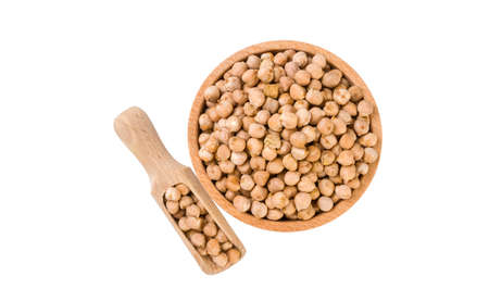 chickpea  in wooden bowl and scoop isolated on white background. nutrition. bio. natural food ingredient.