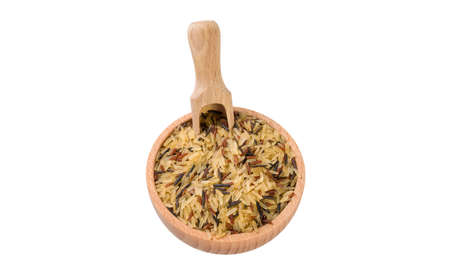rice mix in wooden bowl and scoop isolated on white background. nutrition. bio. natural food ingredient. variety of white parboiled,red and wild rice.