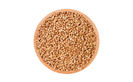 roasted buckwheat in wooden bowl isolated on white background. nutrition. food ingredient.top view. 版權商用圖片