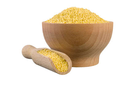 millet groats  in wooden bowl and scoop isolated on white background. nutrition. bio. natural food ingredient.