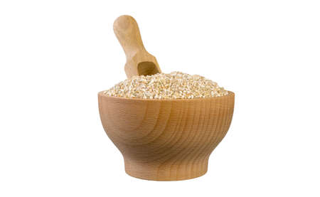 fine ground barley in wooden bowl and scoop isolated on white background.