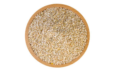 fine ground barley in wooden bowl isolated on white background.