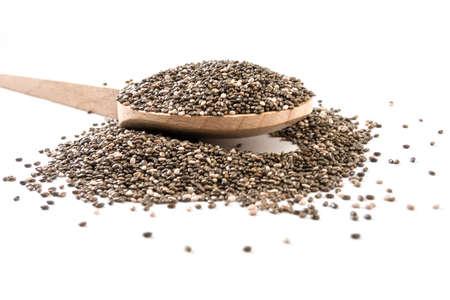 chia seeds on wooden spoon on white background Stock Photo