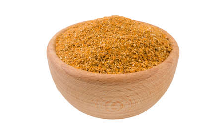 herb or herbal pepper mix in wooden bowl isolated on white background.45 degree view. Spices and food ingredients.