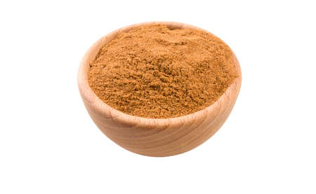 milled or ground nutmeg in wooden bowl isolated on white background. 45 degree view. Spices and food ingredients.